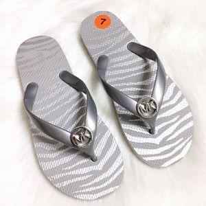 MICHAEL Michael Kors grey silver flip flop sandals